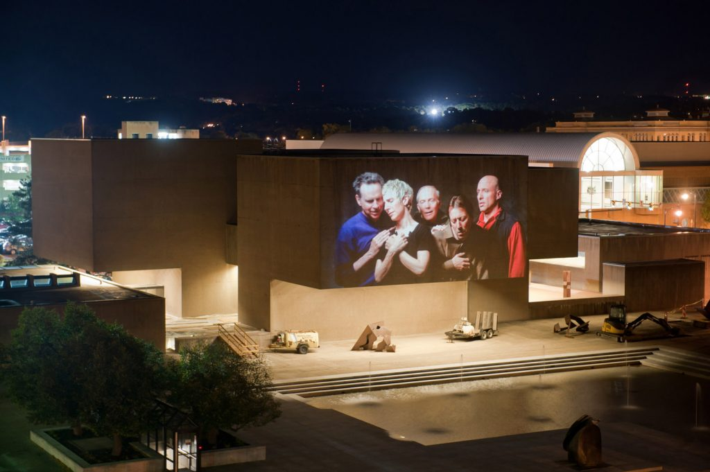 "Urban Video Project (UVP) installation view of Bill Viola's ""Quintet of the Astonished"" projected onto the Everson Museum Exterior in Autumn of 2010. ""Quintet of the Astonished"" was the first piece screened at UVP's flagship Everson venue. Bill Viola, who has gone on to produce multimedia art to international acclaim, was a Syracuse University alumnus and had his first solo show at the Everson Museum of Art nearly 40 years earlier. Urban Video Project (UVP) is an important international venue for the public exhibition of video art and a multimedia public art initiative of Light Work and Syracuse University operating on the Connective Corridor cultural strip in Syracuse, N.Y.UVP Everson, a partnership with the Everson Museum of Art, is UVP's flagship site. UVP Everson is located on the north façade of the Everson Museum of Art building at 401 Harrison St. in downtown Syracuse, and transforms the plaza every Thursday-Saturday from dusk to 11 p.m., year-round into a public art installation utilizing a permanently installed extra-large venue projector and stereo sound system. More information at www.urbanvideoproject.com"