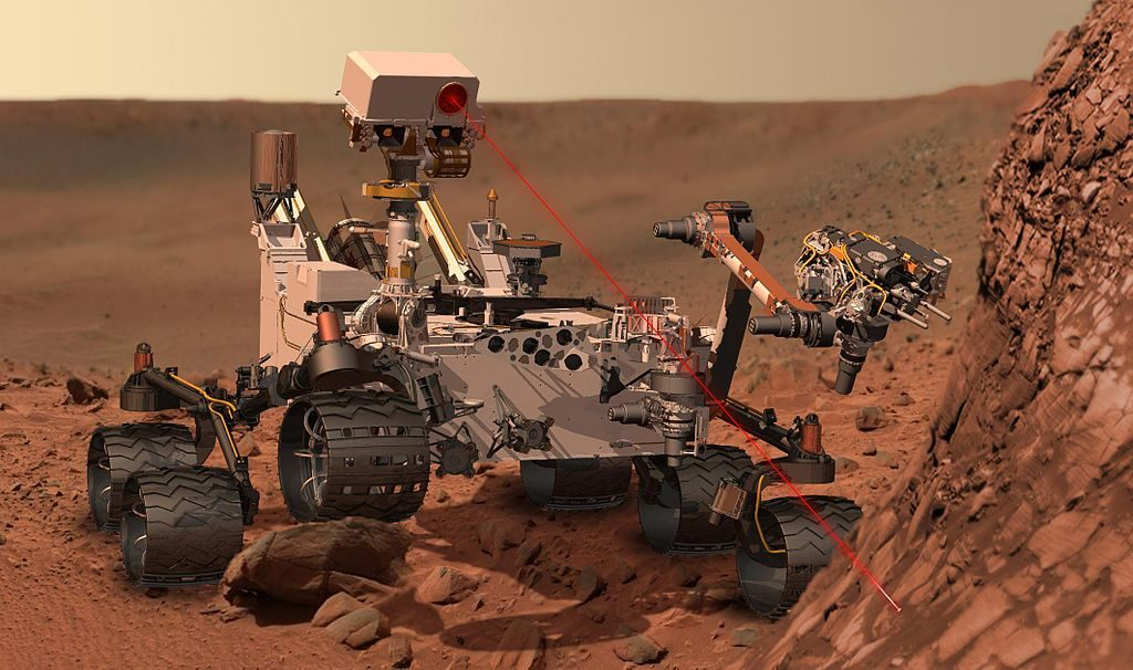 1024px-Curiosity_at_Work_on_Mars_(Artist's_Concept)
